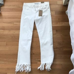 White flared frayed jeans